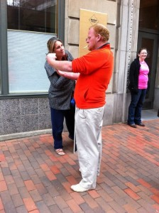 Leslie Sneddon talks to a man who stops to observe the outreach.