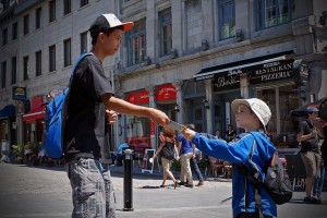 Sippley's son gives Gospel literature to a teenager on the streets of Quebec.