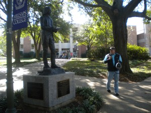 OSA preaches near a Wesley statue at Millsap College minutes before being ejected from the campus.