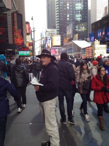 Adams preaches to the crows in Times Square.