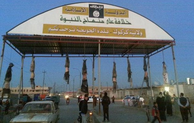 Dangling Dead Bodies at City Entrance, Child Parading Head Through Streets Show ISIS' Barbarity