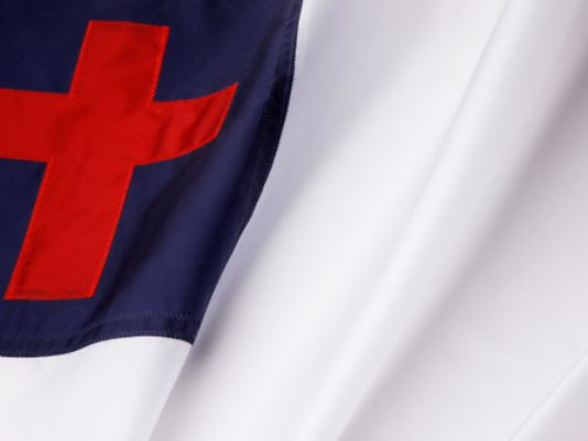 Atheist Activist Group Seeks Removal of Christian Flag from School Board Meeting Room