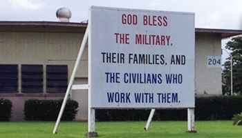 Group Demands Removal of 'God Bless the Military' Sign Over Religious Reference