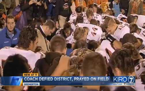 Crowd Joins Christian Coach on Field for Prayer After District Bans Student Participation