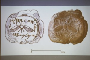 A projected image of a clay imprint, known as a bulla, which was unearthed from excavations near Jerusalem's Old City, and later discovered to be from the seal of the biblical King Hezekiah, is displayed during a news conference at The Hebrew University in Jerusalem December 2, 2015. REUETRS/Amir Cohen