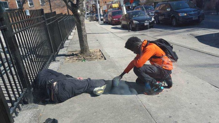 Maryland Police Officer's Photo of Teen Praying Over Homeless Man Goes Viral