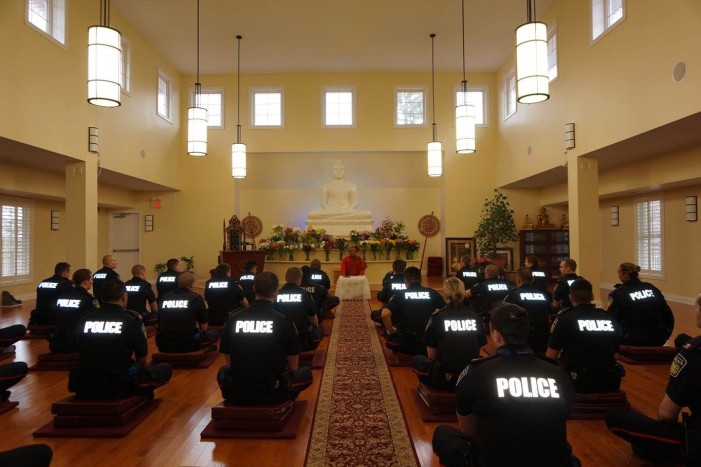 Canadian Police Officers Practice Meditation in Buddhist Temple as Part of Training