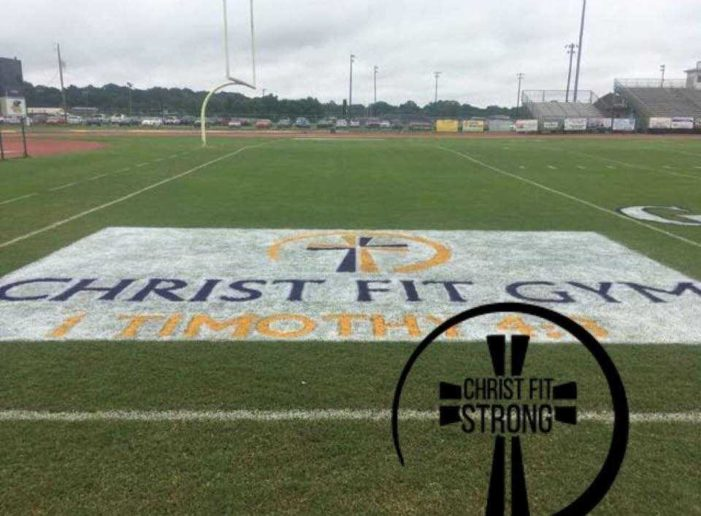 School Board Decides to Fight Lawsuit After Initially Ordering Students to Paint Over Christian Logo on Football Field