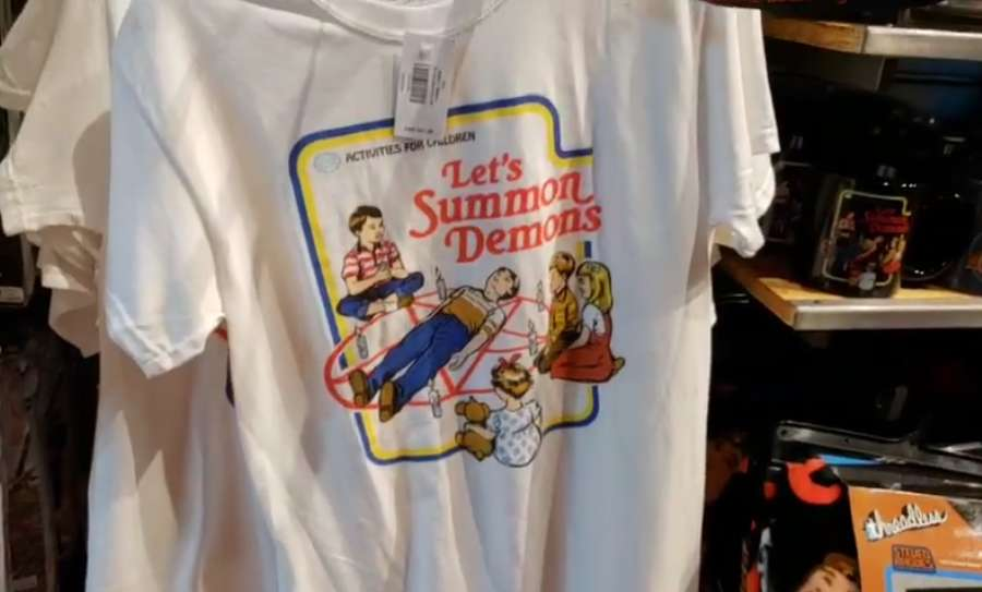 "1d2cba56 A video posted to social media informing Christians that mall retailer  Spencer Gifts sells t-shirts bearing messages such as ""Let's Summon Demons""  and "" ..."