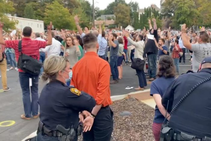 Idaho Residents Arrested at City Hall for Singing Hymns Maskless to Push Back Against Mask Mandate