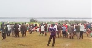 Crowds at Lake Lemwa, Uganda on Sept. 1, 2021 await recovery of the body of Dante Tambika, killed the previous night. (Morning Star News)